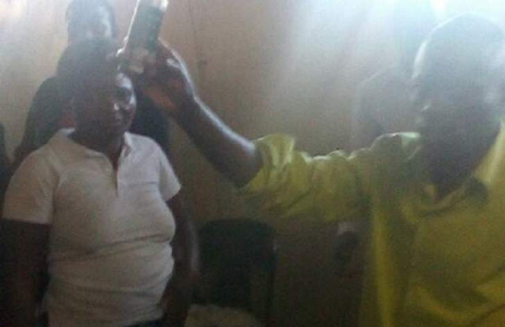 Pastor sprays anointed perfume into congregants' mouths