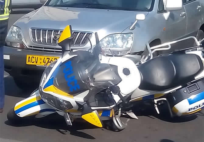 Mugabe's biker in horrific accident