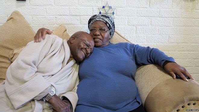 Desmond Tutu back home in his wife's arms